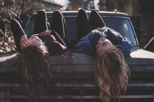 two girls on a car